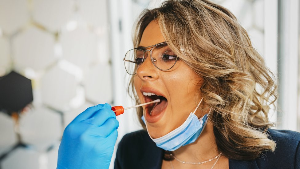 Woman being swab-tested