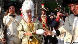 Re-enactors portray Marie-Antoinette at her beheading during Philadelphia's annual Bastille Day celebration in 2004