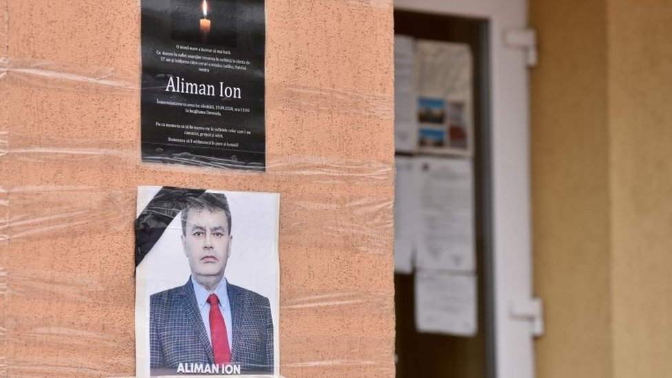 An obituary photo of former mayor Ion Aliman is taped on to the walls of the city hall in Deveselu, southern Romania, September 28, 2020