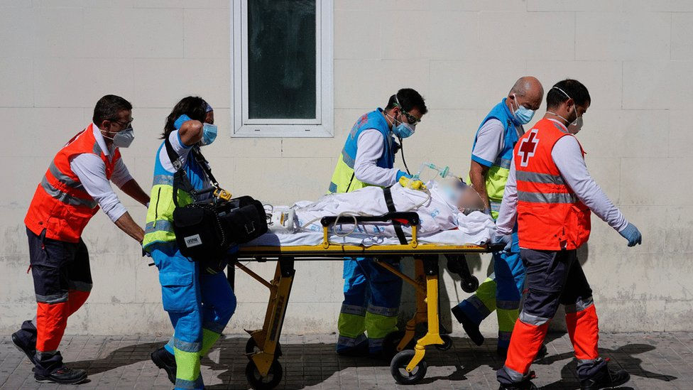 Health workers push a stretcher with a patient in the emergency unit at 12 de Octubre hospital amid the coronavirus disease (COVID-19) pandemic, in Madrid, Spain, September 2, 2020