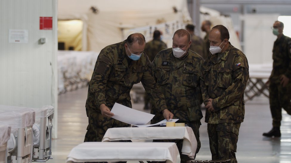 Colonel Slechta (left) with colleagues in field hospital