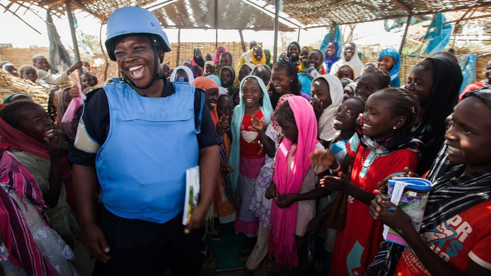 Ghanaian UN policewoman with refugee children in Darfur, Sudan, May 2014