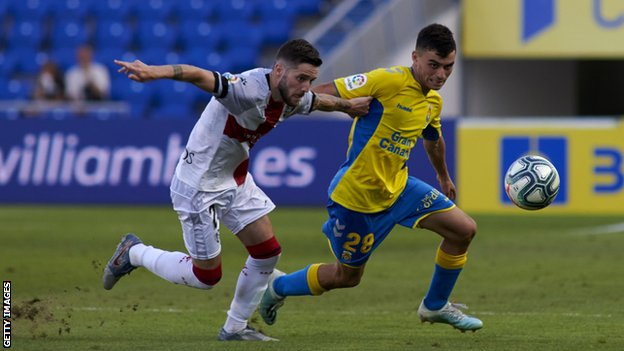 Pedri (r) making his professional debut for Las Palmas in August 2019 in a second tier defeat by Huesca