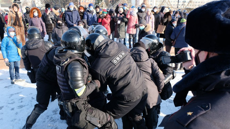 Riot police officers detain a participant in an unauthorized rally in support of Russian opposition activist Alexei Navalny in Khabarovsk