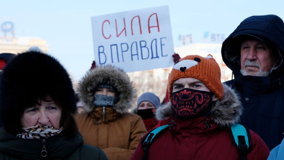 """A participant holds a poster reading """"Strength is in the Truth"""" during an unauthorized rally Khabarovsk"""