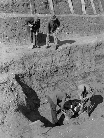 31 July 1939: Workmen sift through earth at the bottom of the excavation of the Anglo-Saxon burial ship at Sutton Hoo, Suffolk.