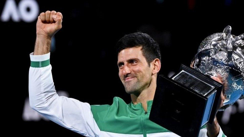 Novak Djokovic celebrates winning the 2021 Australian Open