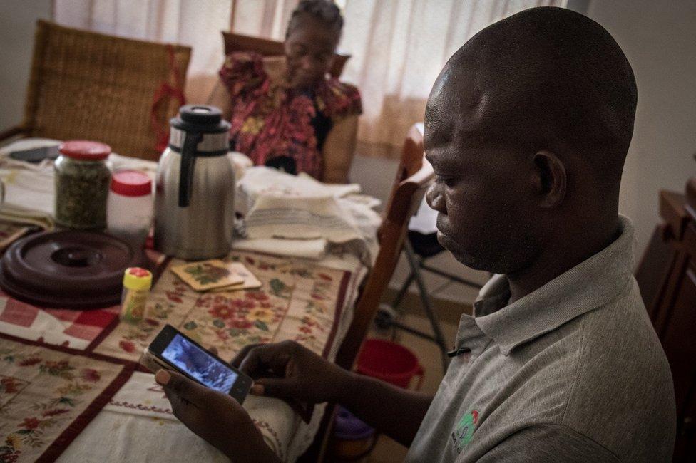 Man looking at a phone