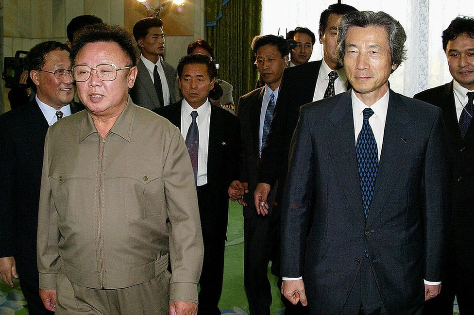 Japanese Prime Minister Junichiro Koizumi walks with North Korean leader Kim Jong-Il before their talks in Pyongyang on 17 September 2002.