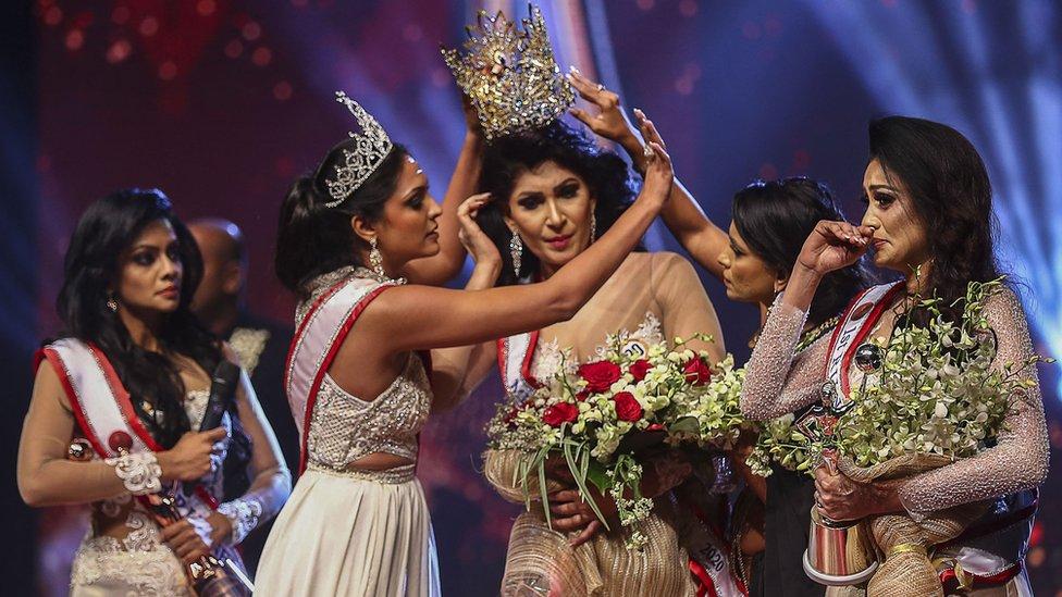 winner of Mrs. Sri Lanka 2020 Caroline Jurie removes the crown of 2021 winner Pushpika de Silva