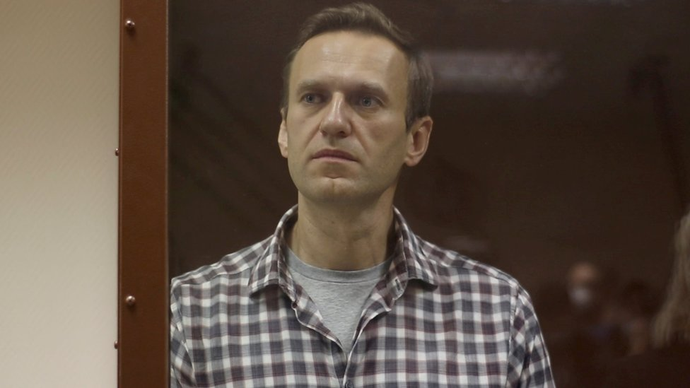 Kremlin critic Alexei Navalny stands inside a defendant dock during a court hearing in Moscow on 20 February